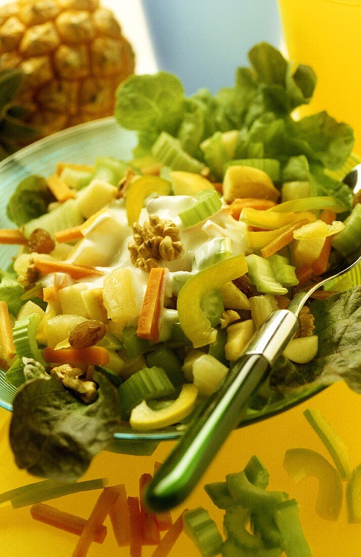 Waldorf salad with celery, pineapple and walnuts