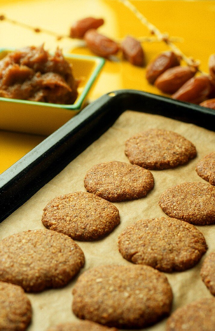 Biscuits on baking tray, date paste beside it