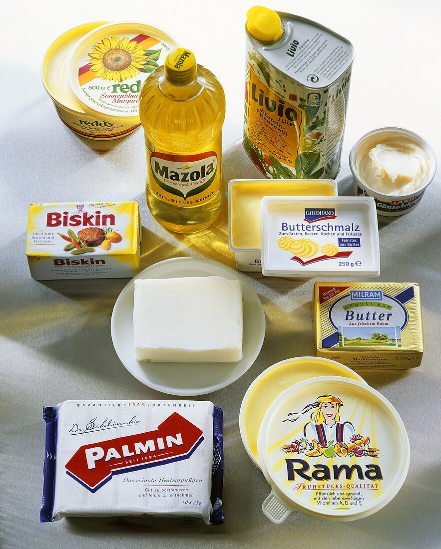 Various fats and oils, some in packaging