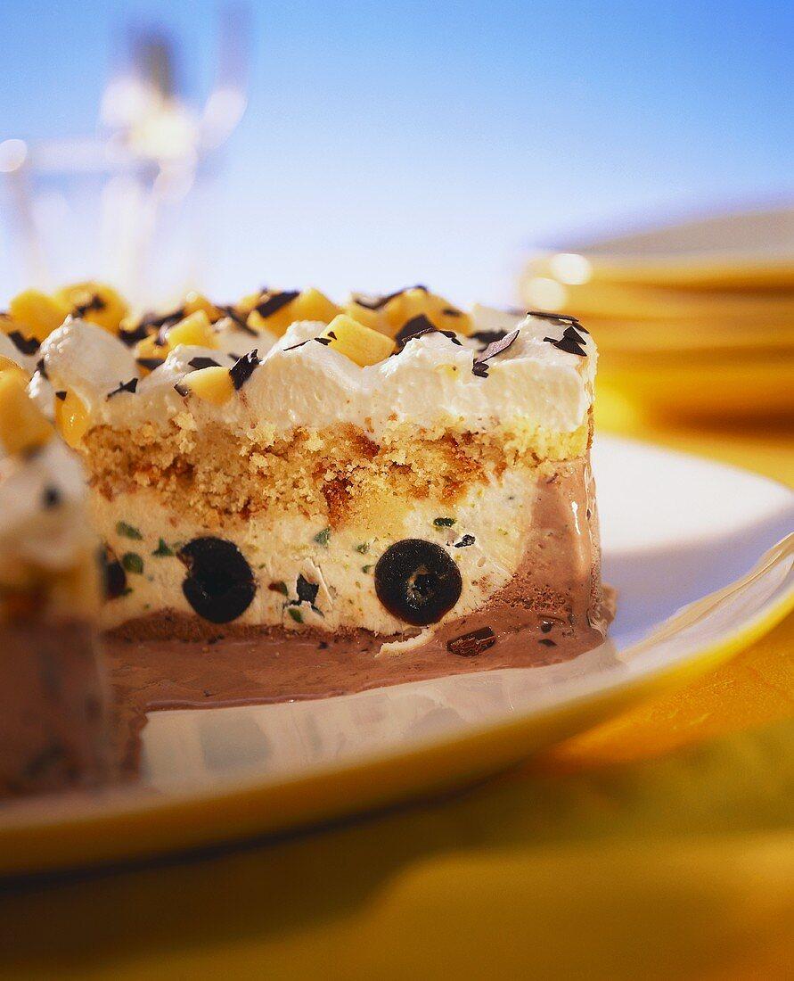 Ice cream torte with black cherries, cream and mango