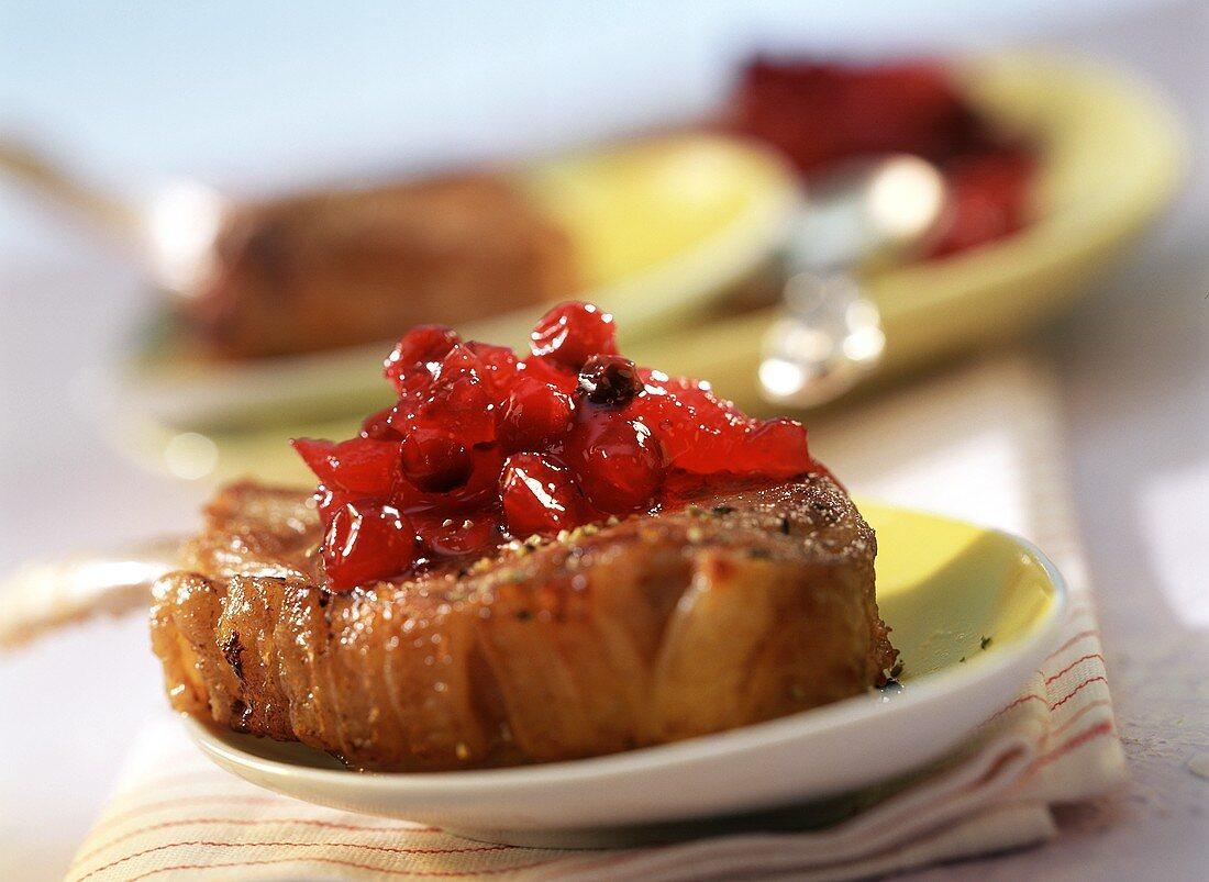 Cranberry preserve with Campari on steak