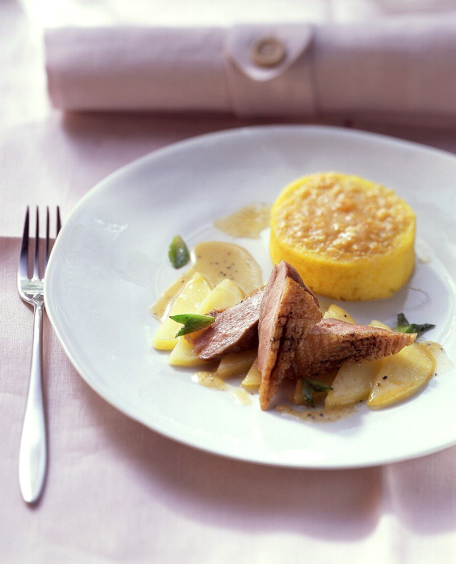 Duck breast with polenta gratin and minted apple sauce