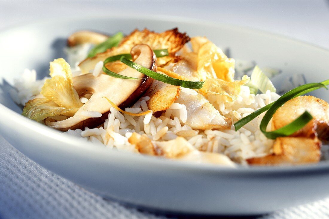 Fried rice with fish, mushrooms and Chinese cabbage