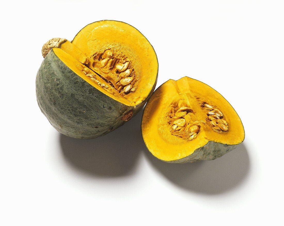 Green pumpkin (variety: Kabocha), cut into