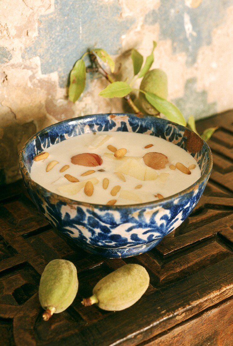 Spanish almond soup in blue and white bowl