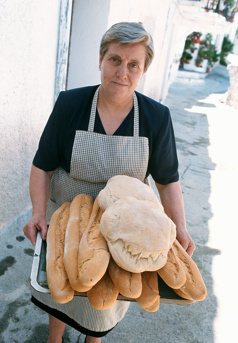 Village baker with fresh bread in Capileira, Andalucia