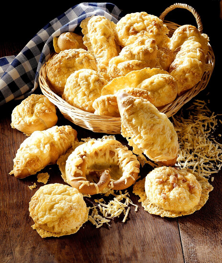 Assorted cheese biscuits, some in bread basket