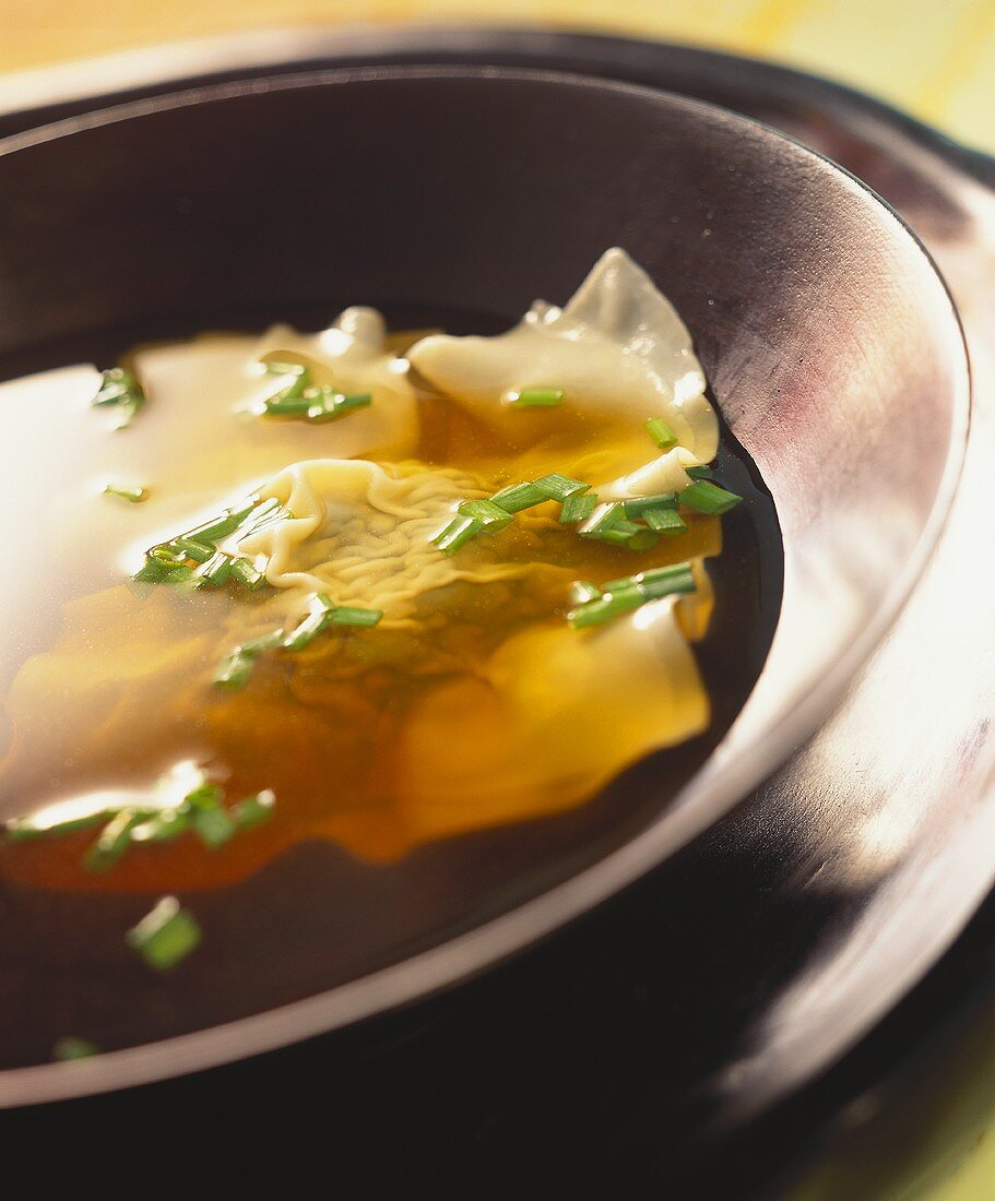 Broth with won tons and chives