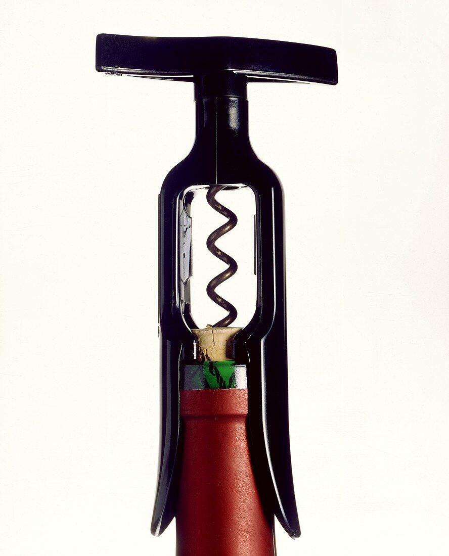 Corkscrew on red wine bottle
