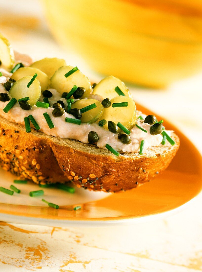 Wholemeal bread with ham mousse, gherkins and chives