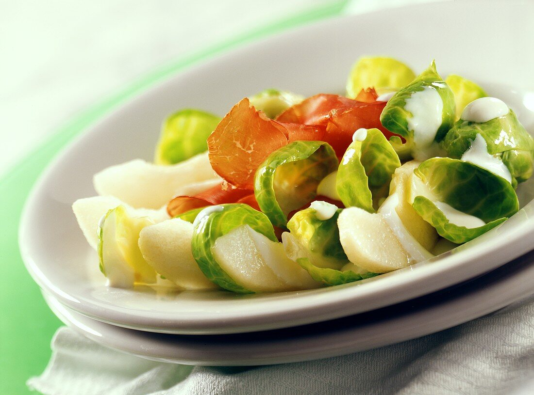 Brussels sprout salad with Parma ham and pears