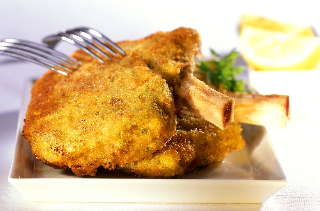 Costolette alla milanese (breaded veal cutlets, Italy)