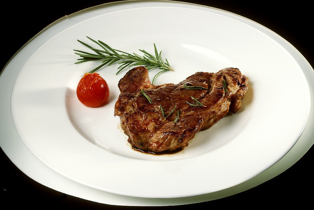 Cutlet with rosemary and cherry tomato