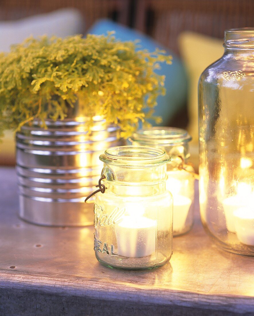 Tea lights in preserving jars; twigs in tin