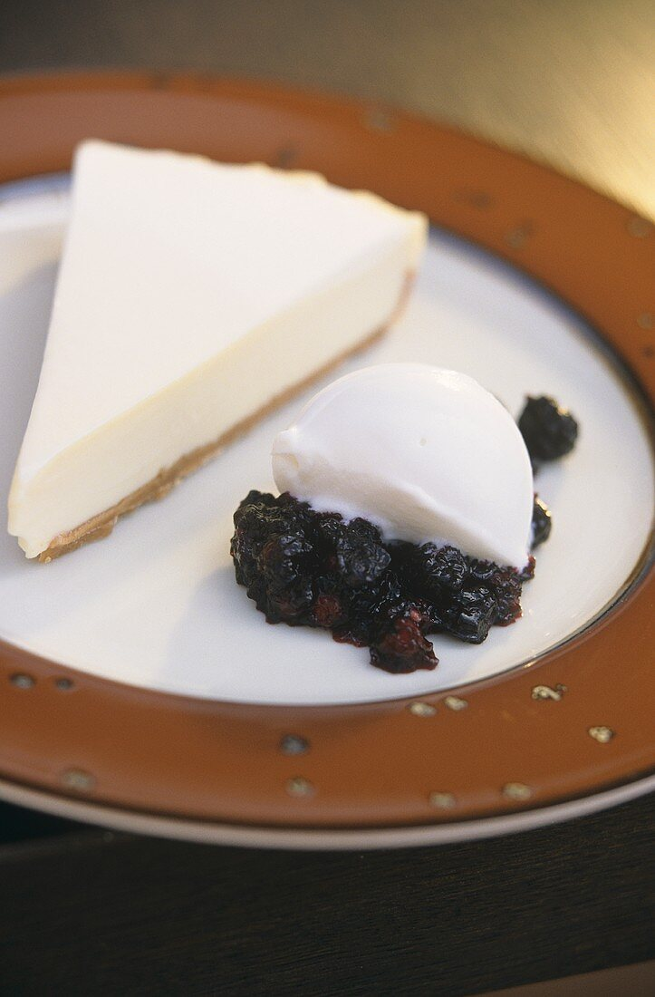 Piece of cheesecake and yoghurt mousse on compote