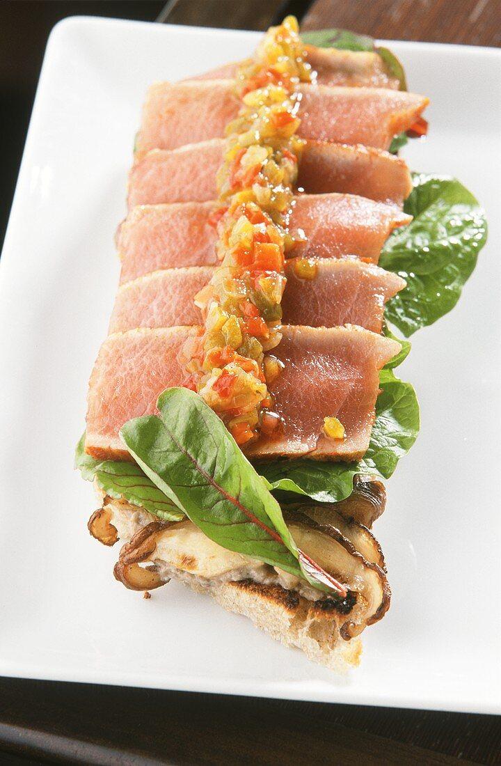 Tuna with shiitake mushrooms on toasted baguette