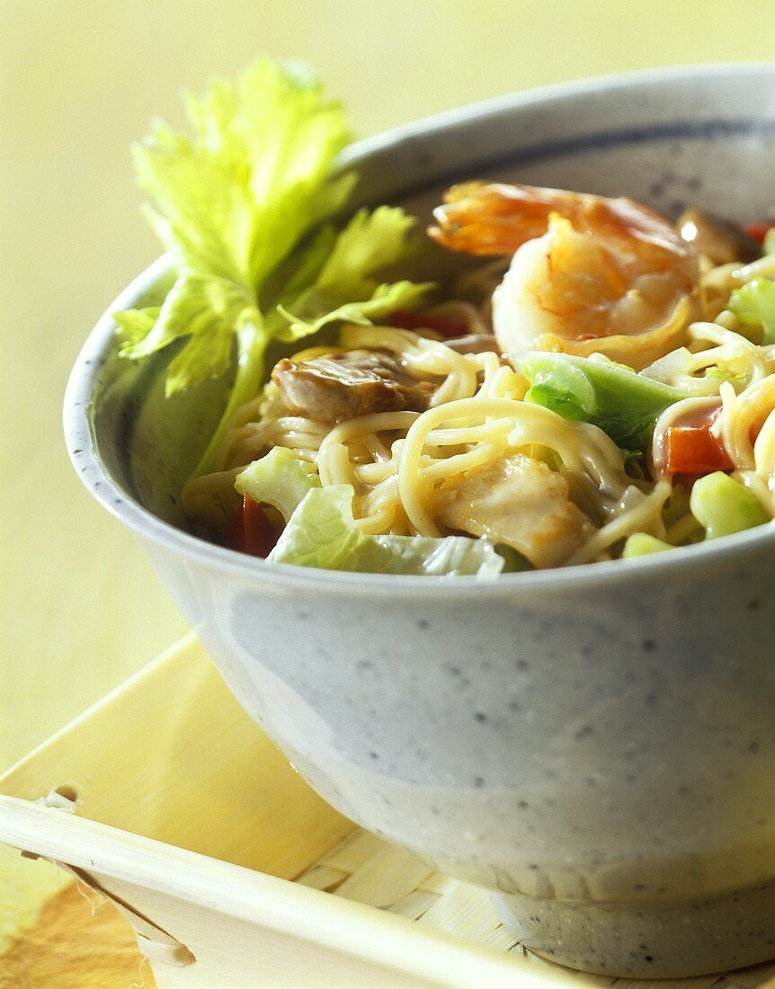 Chicken chow mein with noodles, vegetables, shrimps, from wok