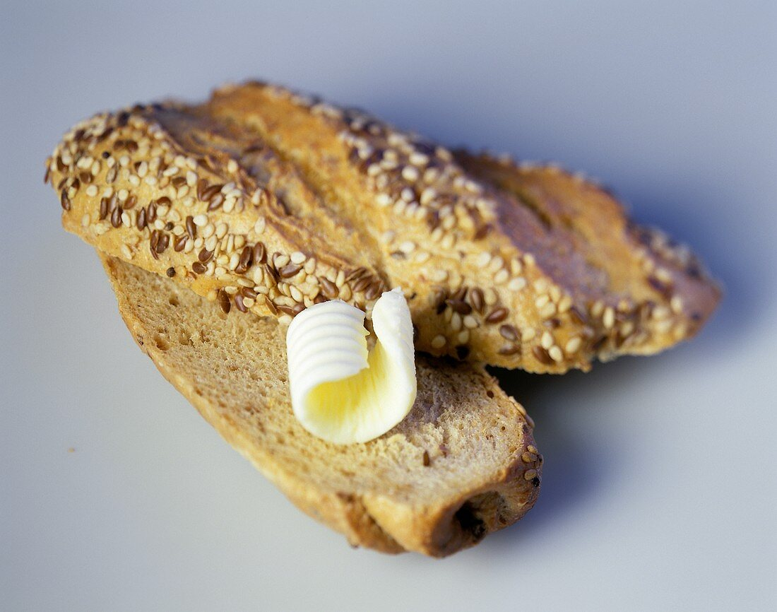 Wholemeal roll with a butter curl