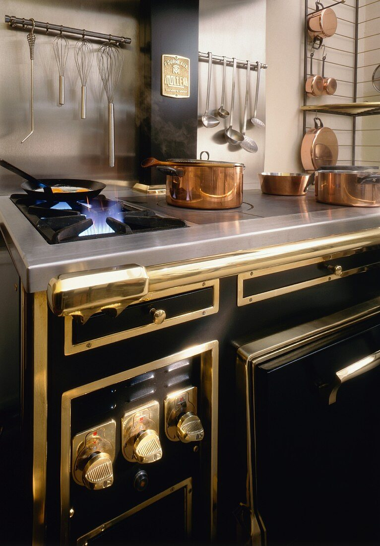 Kitchen with gas cooker and copper pans