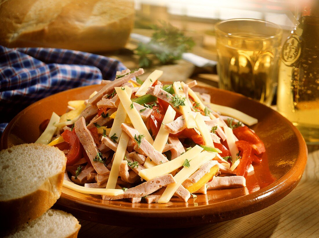 Alsatian sausage salad with cheese and baguette