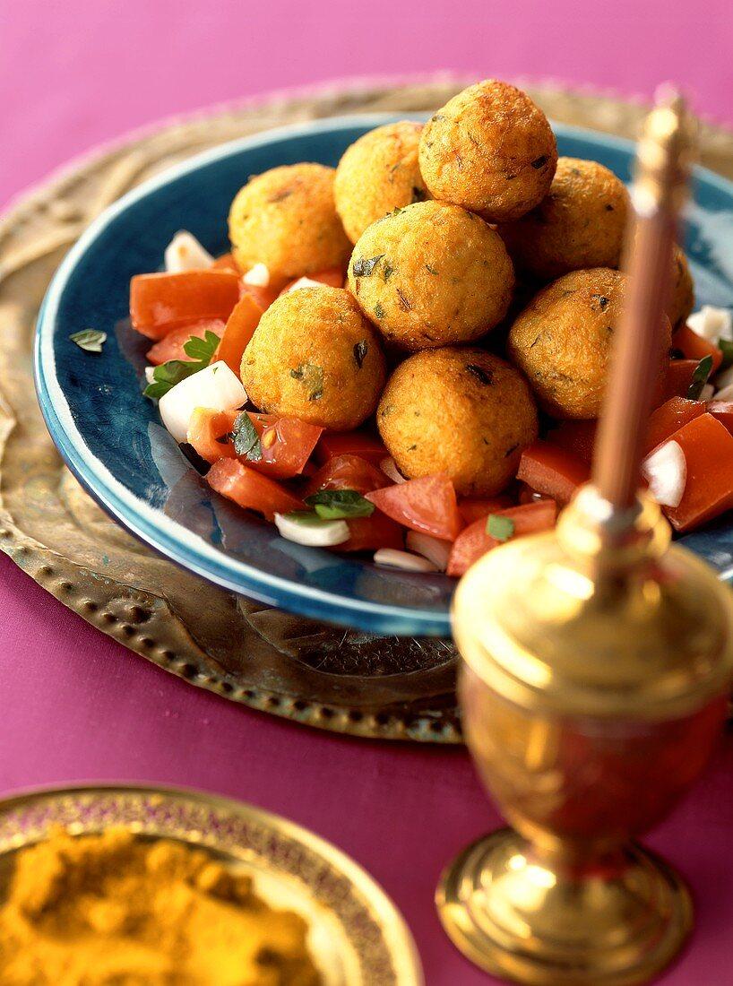 Arab potato and bulgur balls on tomato salad