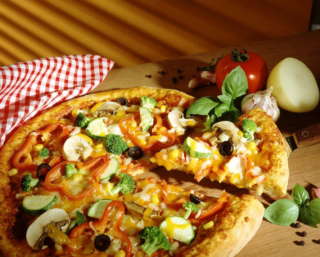 Vegetable pizza with mushrooms and basil