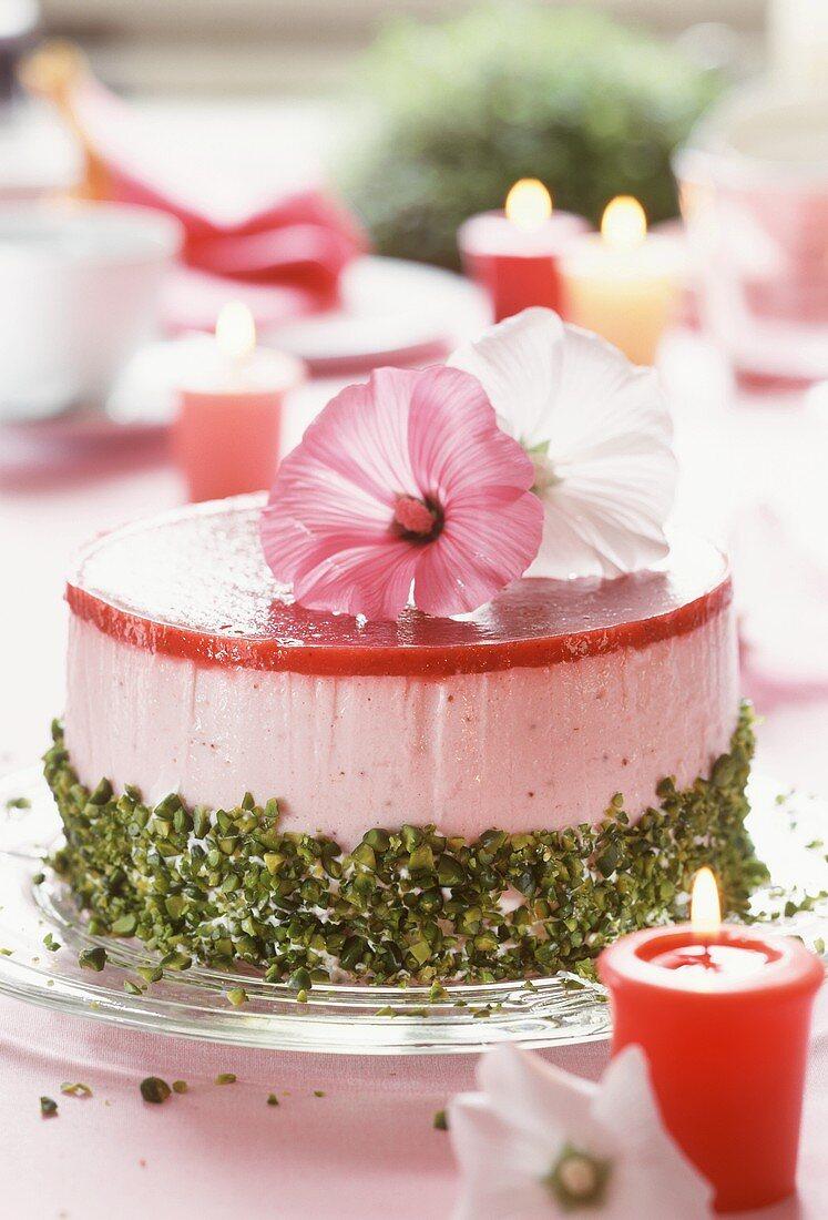Strawberry yoghurt cake with pistachios & flower decoration