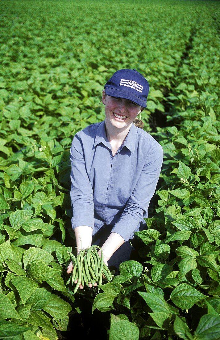 Australian female farm worker in bean field