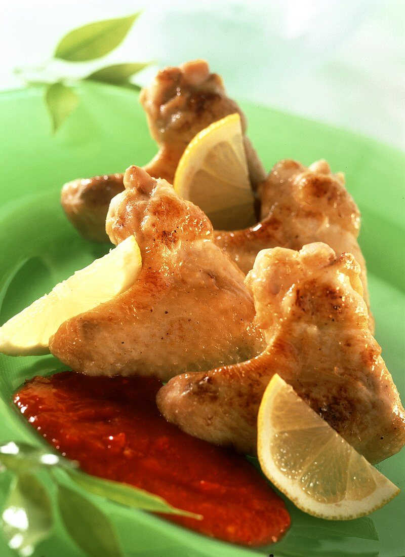 Chicken wings with pepper mousse and lemons