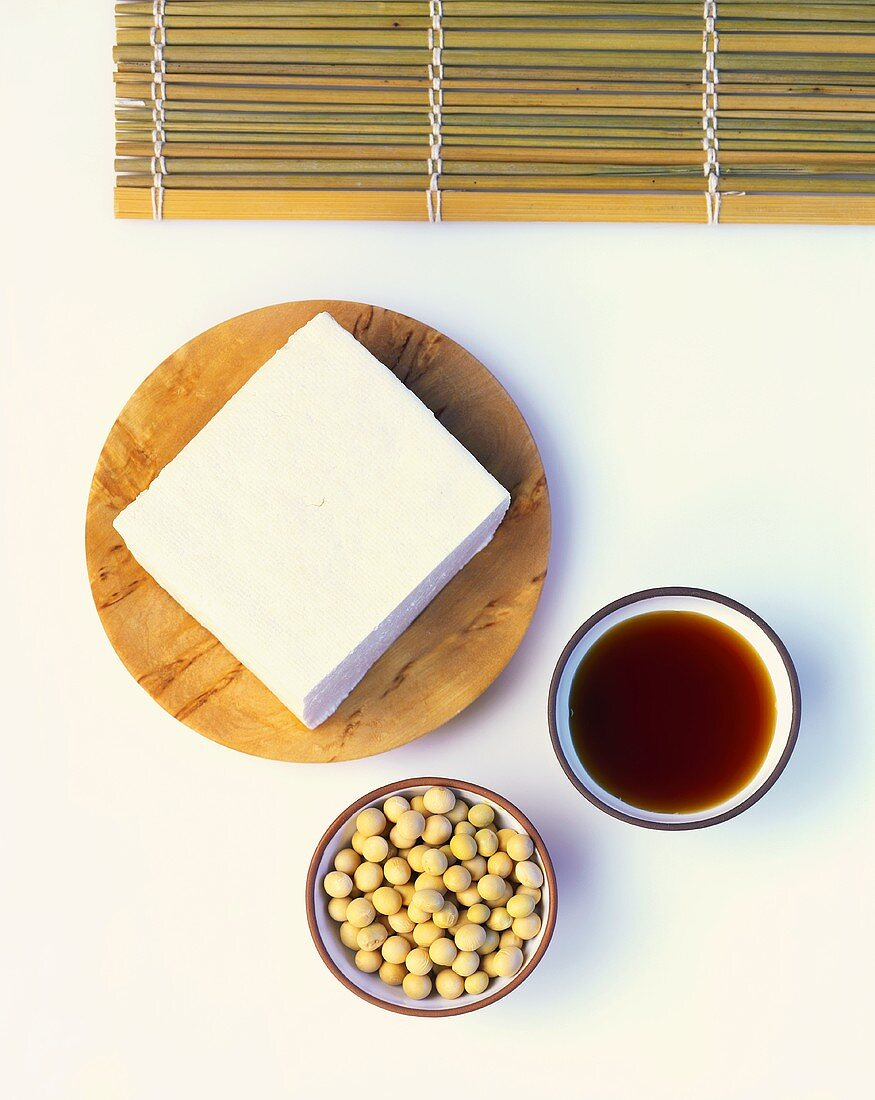 Slices of tofu, soya beans and soy sauce