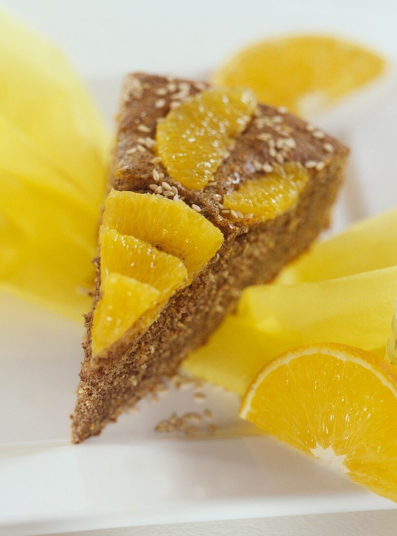 Piece of orange and date cake with sesame