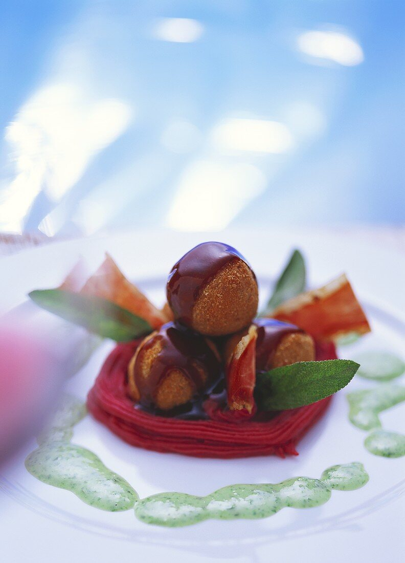 Oxtail chocolates on beetroot puree with herb sauce