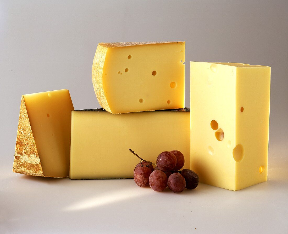 Various types of hard cheese from Vorarlberg; red grapes
