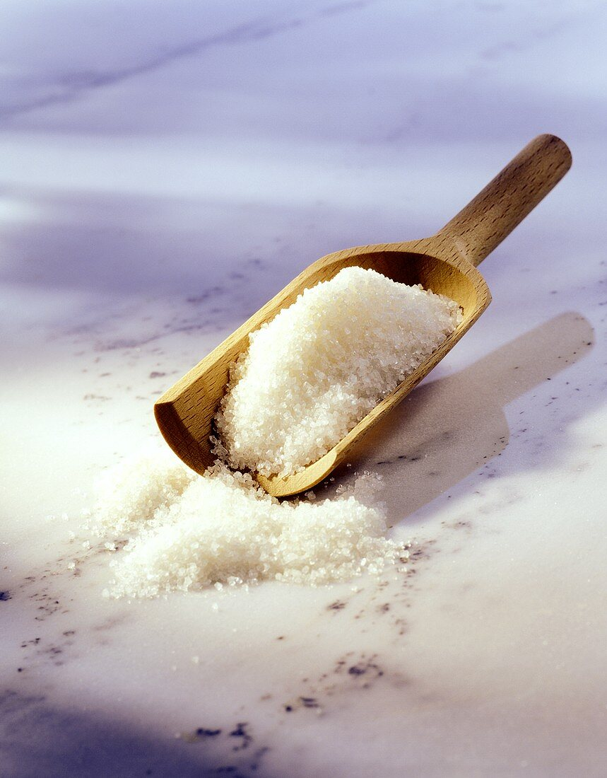 Preserving sugar with wooden scoop