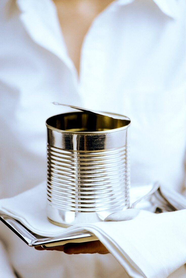 Waitress serving food tin on tray