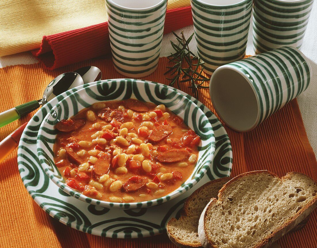 Serbian bean soup with sausage; slices of bread