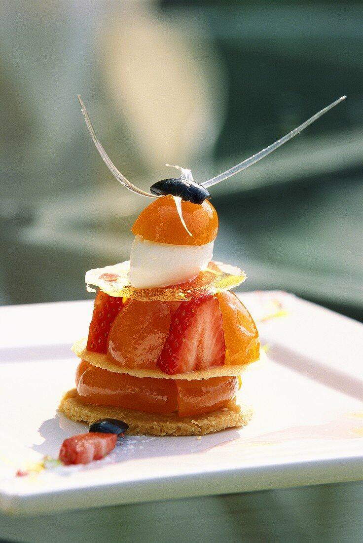 Small fancy with strawberries, kumquats and almond ice cream