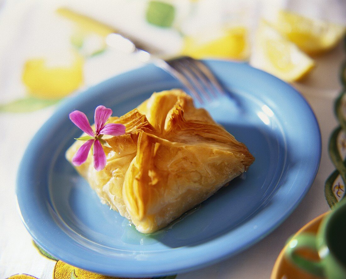 Sweet filo pastry turnover with honey sauce