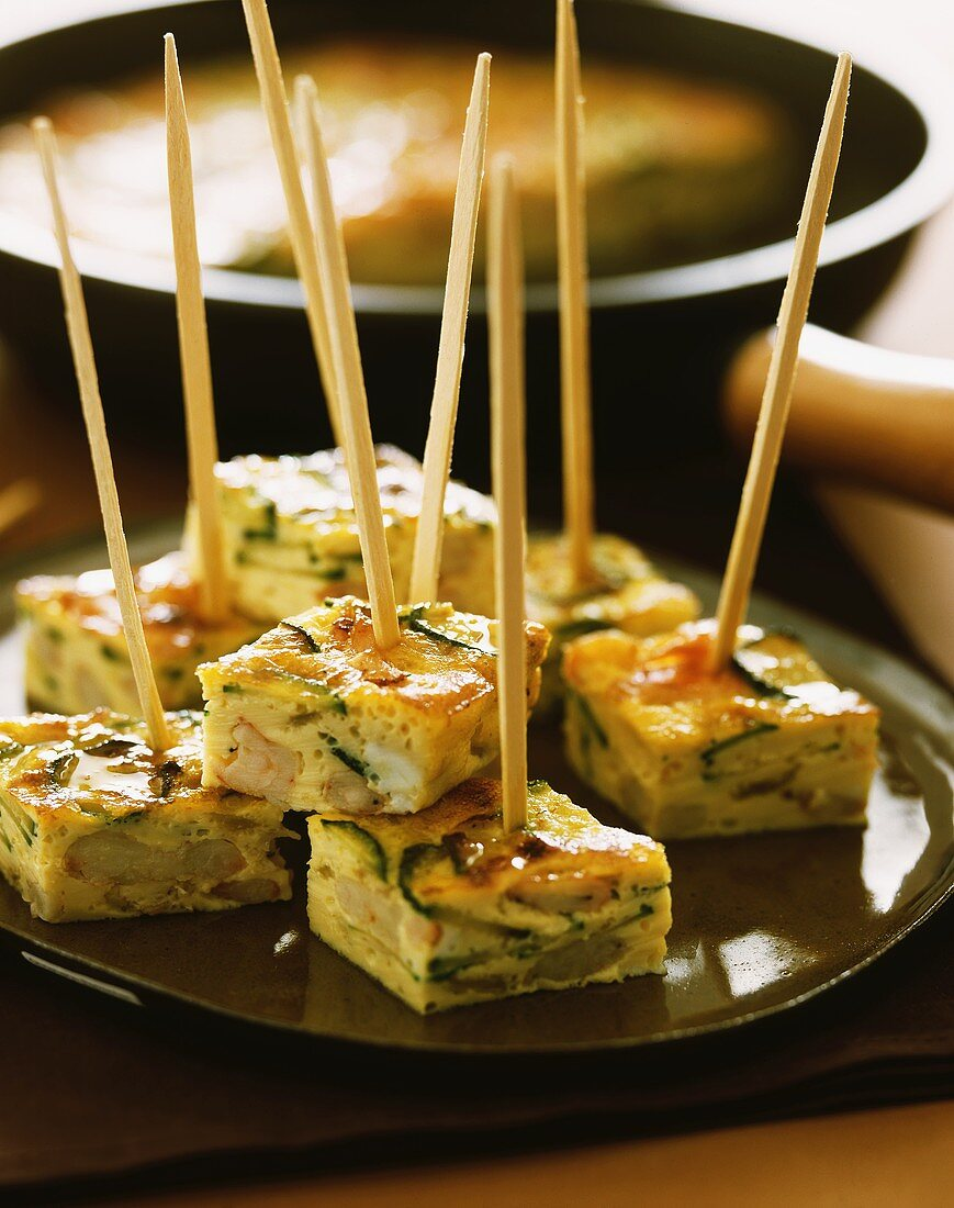 Courgette frittata in pieces on wooden cocktail sticks