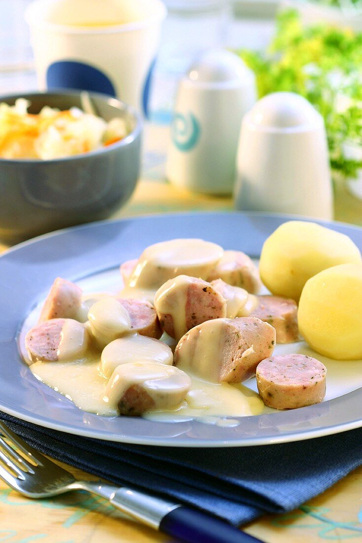 Brühwurst (scalded sausage) in beer sauce with boiled potatoes