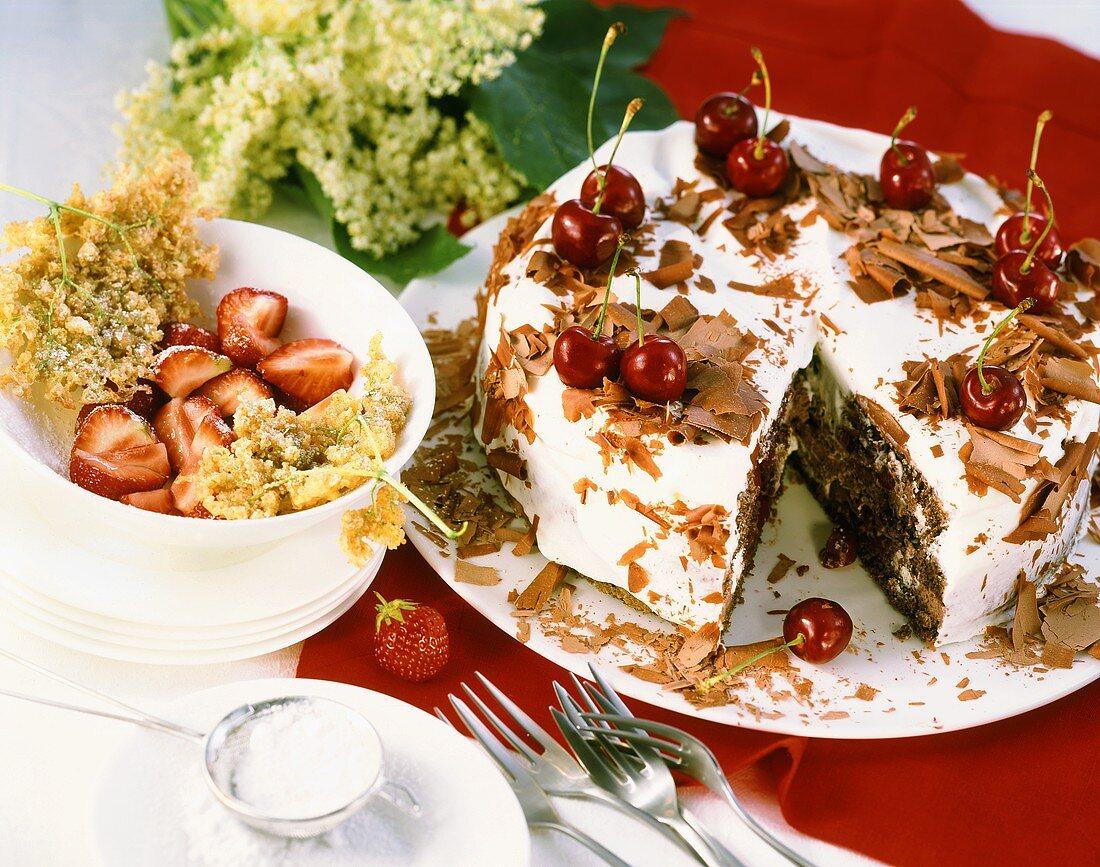Elderflower fritters with strawberries; Black Forest cherry cake