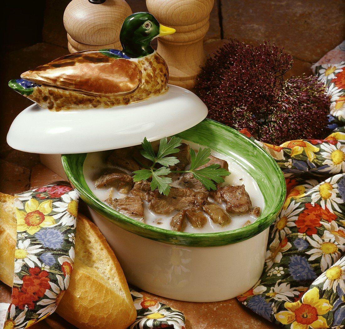 Duck rillettes in a stoneware pot