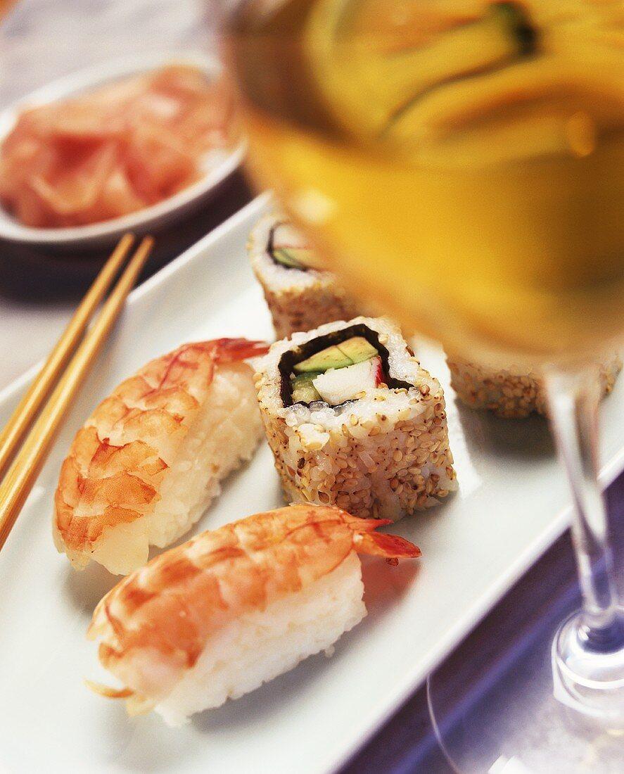 Nigiri sushi with shrimps and California roll