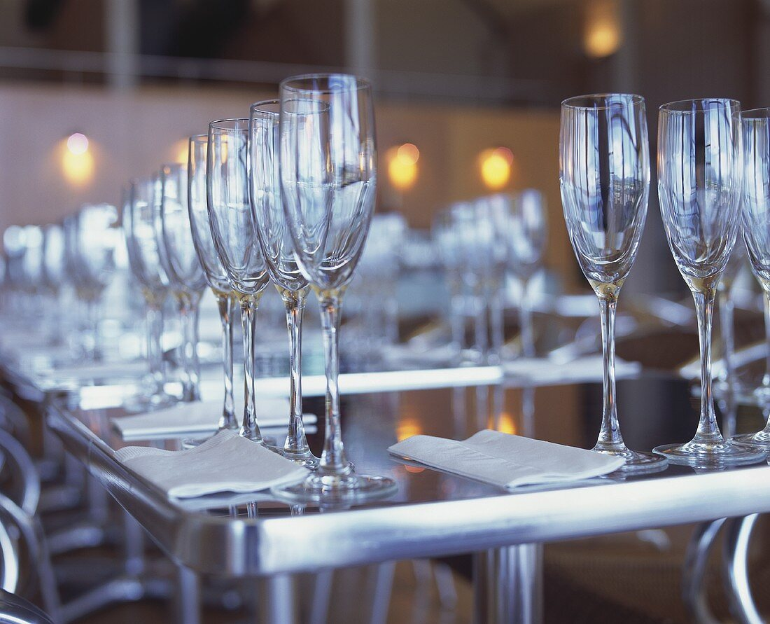 A Long Table Set with Many Champagne Flutes