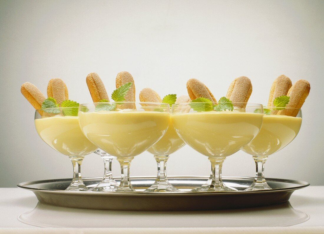 Advocaat mousse with sponge fingers in champagne glasses