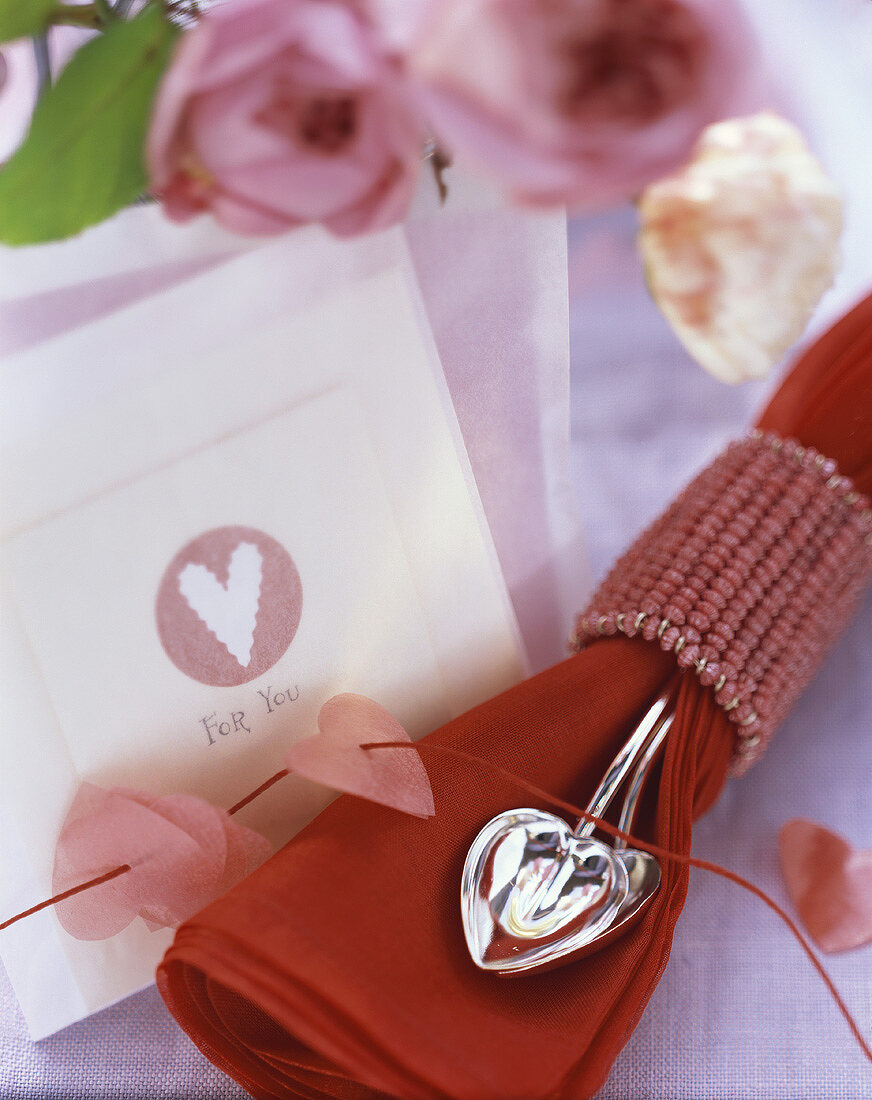 Place-card and napkin for a romantic dinner
