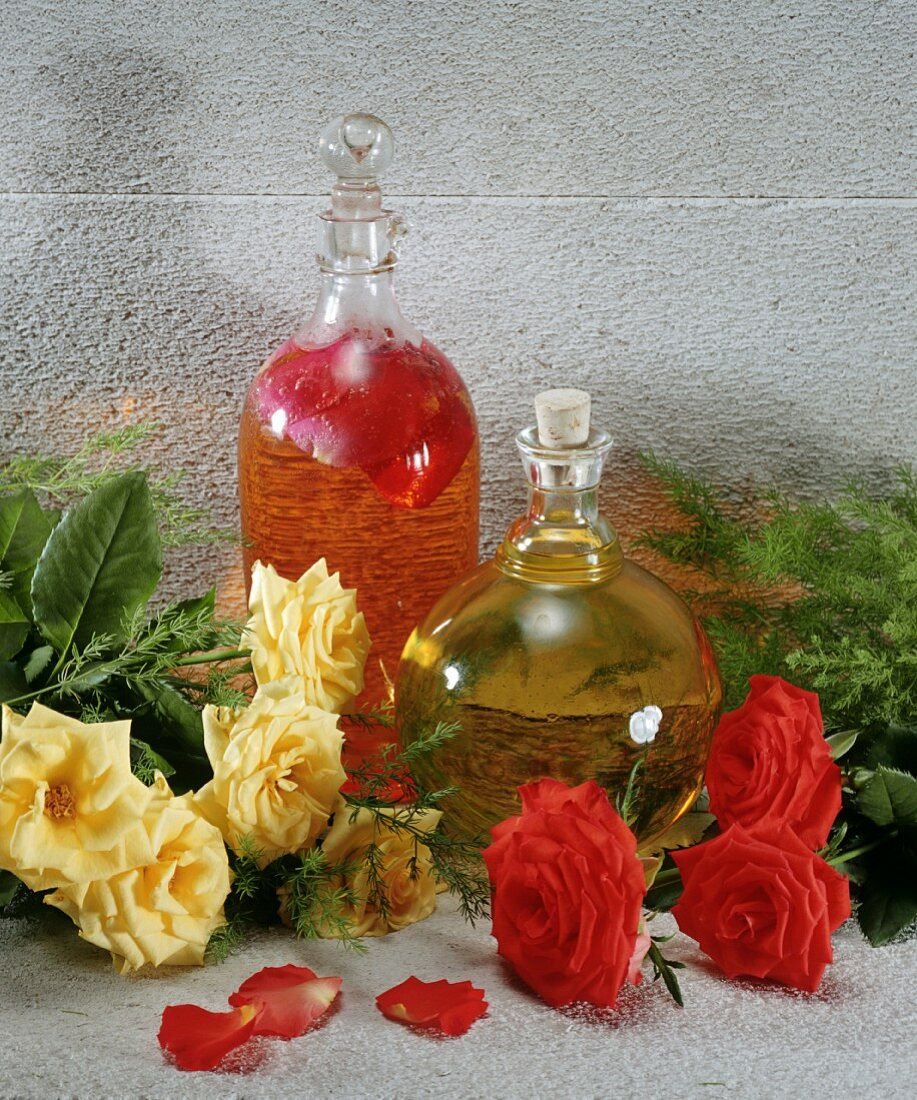 A bottle of rose vinegar & a bottle of rose-hip syrup