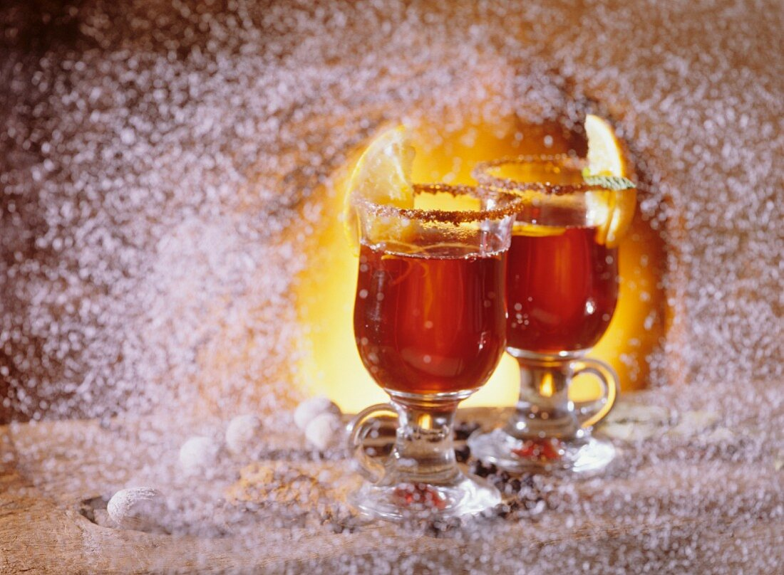 Two glasses of grog in a winter atmosphere