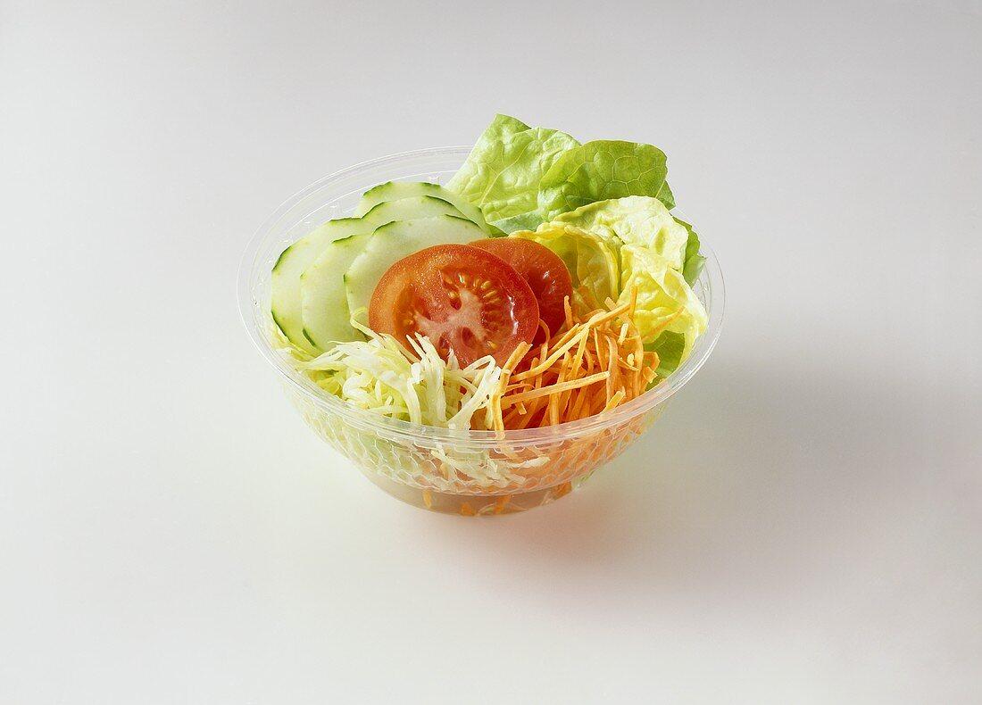 Mixed salad in plastic dish