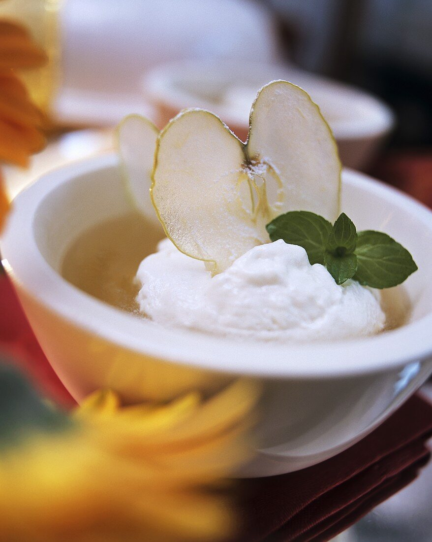 New wine soup with quark dumplings and apple slices